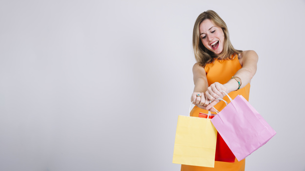 woman-with-shopping-bags-space-left_23-2147707559